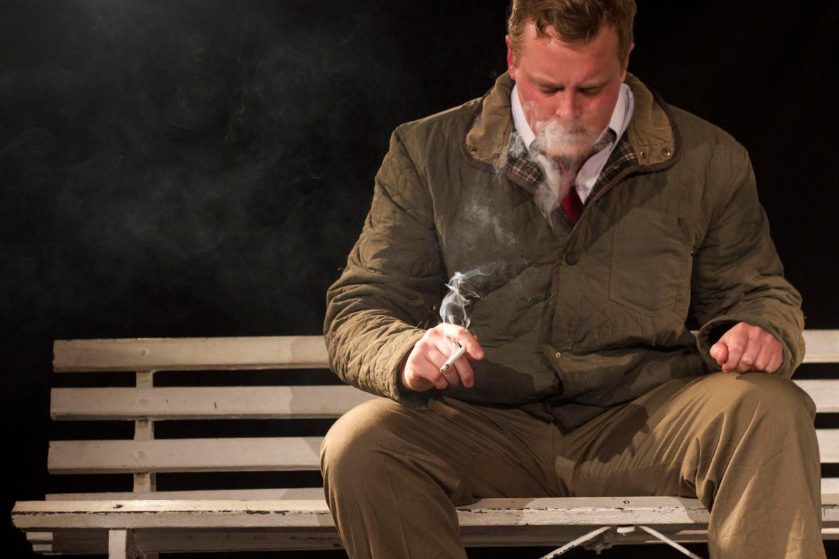 Chad Emslie sits on a bench smoking a cigarette during a performance of Character Door on 2 July 2015 at the National Arts Festival.  Two characters try to break free of their script, but discover that the boundaries between theatre and life are quick to blur, and violence bleeds into one as easily as the other.  (Photo: CuePix/ Amanda Horsfield)